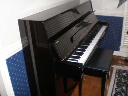 Samick console piano for rent in Lakeland Tn